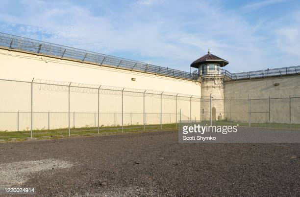 the exercise yard of a decommissioned prison - 刑務所 ストックフォトと画像