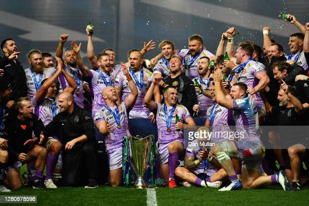 The Exeter Chiefs players and staff celebrate with the trophy following their victory during the Heineken Champions Cup Final between Exeter Chiefs...