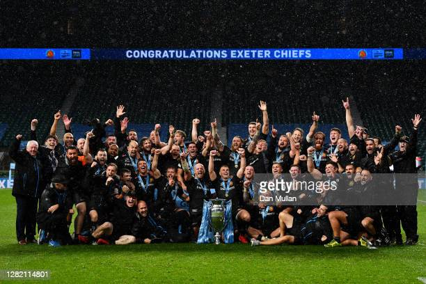 The Exeter Chiefs players and staff celebrate with the trophy following their victory during the Gallagher Premiership Rugby Final between Exeter...