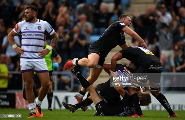 The Exeter Chiefs side celebrates as Henry Slade of Exeter Chiefs scores a try during the Gallagher Premiership Rugby match between Exeter Chiefs and...