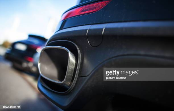 The exhaust of a Porsche Cayenne can be seen on the car in Stuttgart Germany 4 November 2015 After VW exhaust affair Porsche Cayenne will stop...