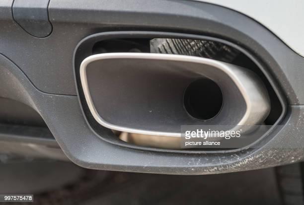 The exhaust pipe of a Porsche Cayenne 30 Liter Diesel photographed in StuttgartZuffenhausen Germany 28 July 2017 German Minister of Traffic Dobrindt...