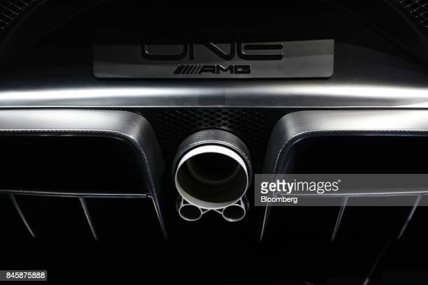 The exhaust pipe sits on a MercedesBenz AMG Project One hypercar during the Daimler AG media night ahead of the IAA Frankfurt Motor Show in Frankfurt...