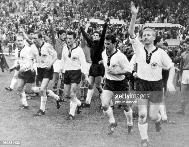 The exhausted but satisfied German players Herbert Erhardt Willi Schulz Hans Nowak Hans Schaefer and KarlHeinz Schnellinger cheer and jubilate as...