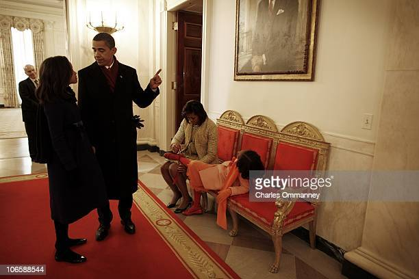 The exhausted First Family arrive back at their new home at 1600 Pennsylvania avenue after President Barack Obama was sworn in by Chief Justice John...