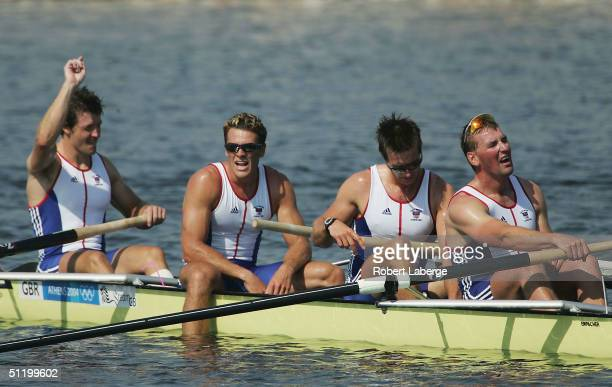 The exhausted Great Britain team of Matthew Pinsent Ed Coode James Cracknell and Steve Williams claim the Gold medal in the men's four rowing final...