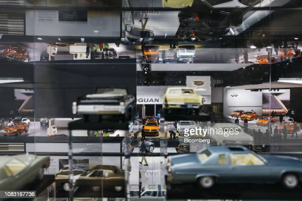 """The exhibit floor is seen through the General Motors Co. Cadillac """"The Evolution of the Tailfin"""" display during the 2019 North American International..."""