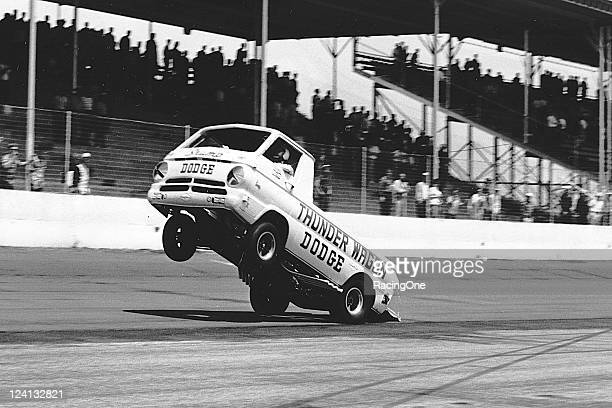 """The exhibition Dodge """"Thunder Wagon"""" performs a wheelie during pre-race activities before a NASCAR Cup race at Darlington Raceway."""
