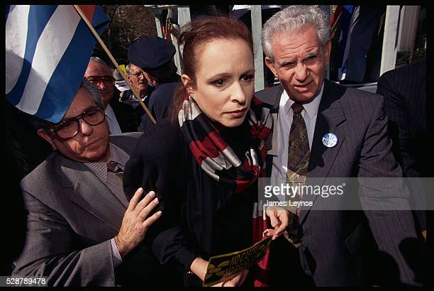 The exiled daughter of Fidel Castro is escorted by bodyguards during an anti-Castro protest.