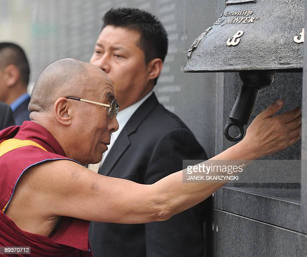 The exiled Tibetan spiritual leader the Dalai Lama rings a bell during a visit on July 28 2009 to a museum in Warsaw dedicated to the illfated 1944...