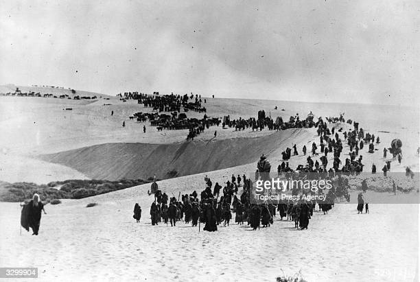 The exodus of the Israelites from Egypt through the desert a scene from the silent film version of 'The Ten Commandments' directed by Cecil B DeMille