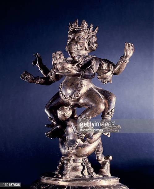 The exotic form of Ganapati with the primary head in the form of the elephant headed Ganesha supported by a monkey goddess enganged in fellatio The...