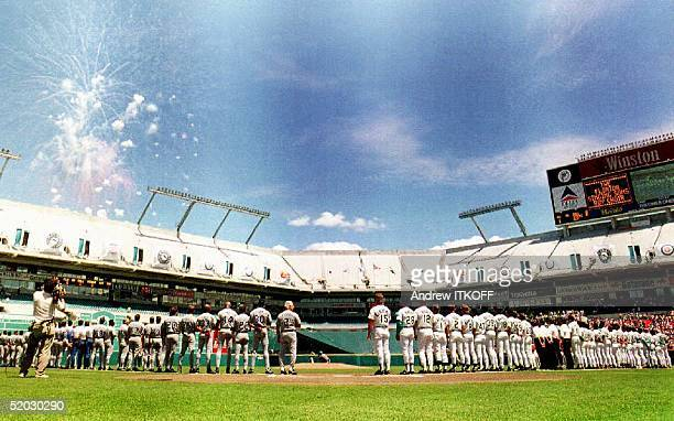 The expansion Florida Marlins listen to the National Anthem along side the Los Angeles Dodgers 06 April 1993 on Opening Day of the 1993 Major League...