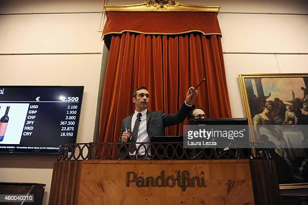 The expert of Rare and Fine wine Department at Pandolfini auction house Francesco Tanzi attends the winter auction at Pandolfini on December 5 2014...