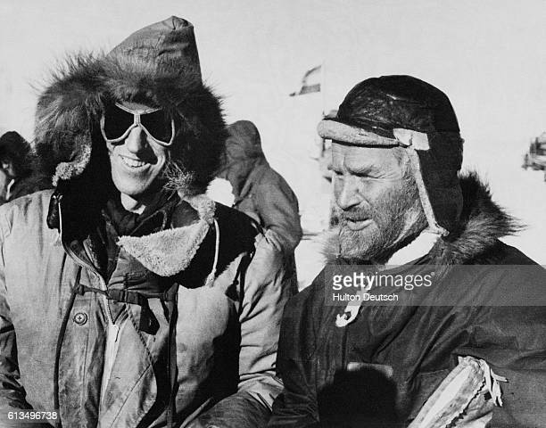 The explorers Edmund Hillary and Vivian Fuchs at the South Pole after they crossed the region overland on the Commonwealth Antarctic Expedition