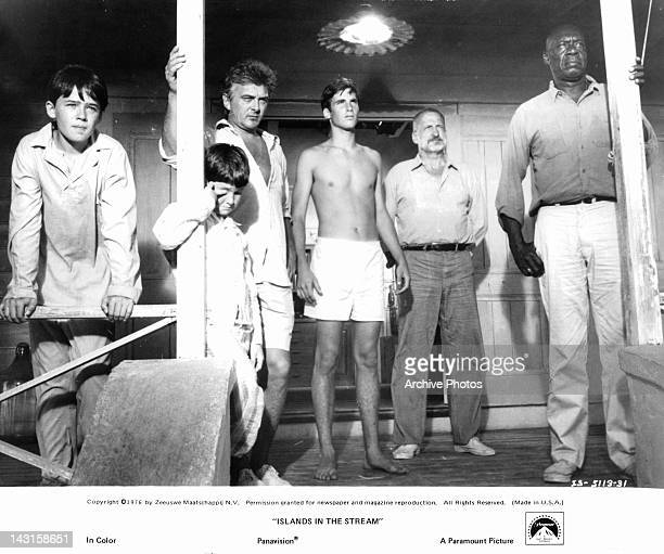 The explosion of an enemy ship awakens MichaelJames Wixted and Brad Savage with others in a scene from the film 'Islands In The Stream' 1976