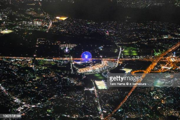 The Expo'70 Commemorative Park in Suita city, Meishin Expressway and Chugoku Expressway night time aerial view from airplane
