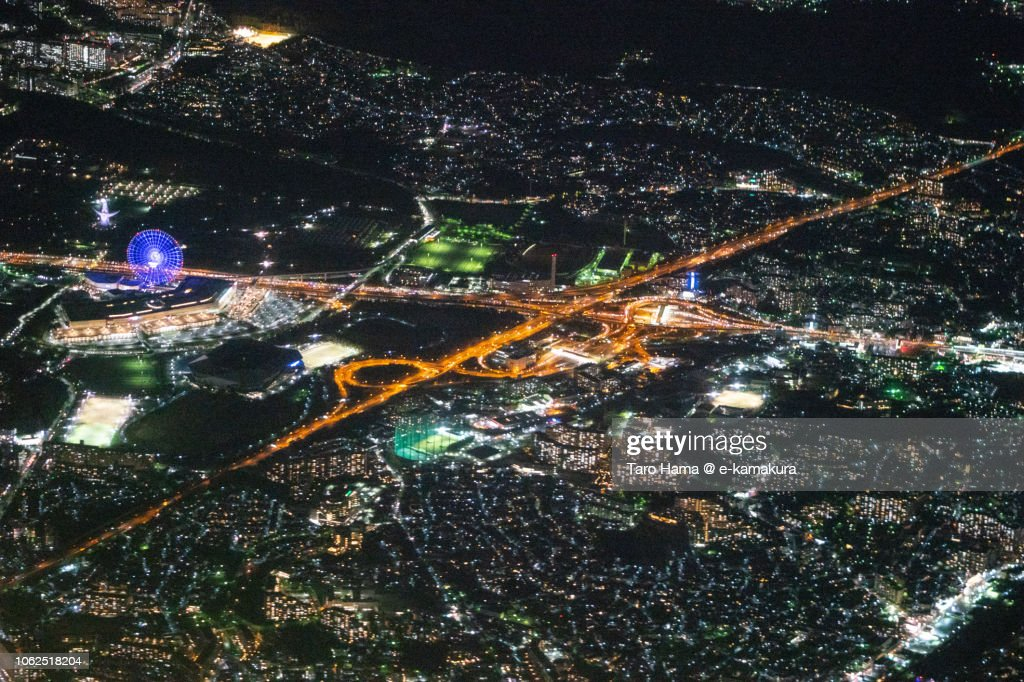 The Expo'70 Commemorative Park in Suita city, Meishin Expressway and Chugoku Expressway night time aerial view from airplane : ストックフォト