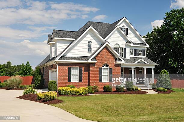 The exterior of a home with a landscaped lawn