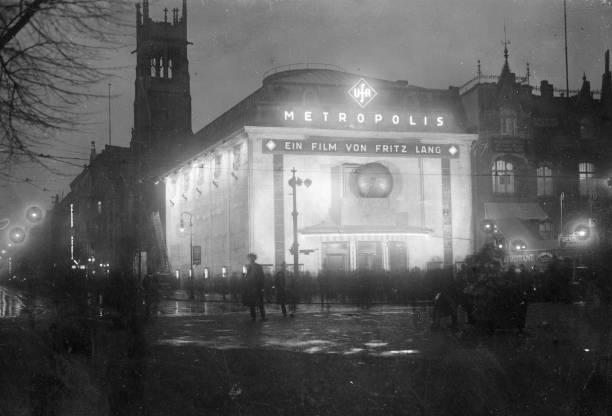 The exterior of a well-lit cinema showing Fritz Lang's...