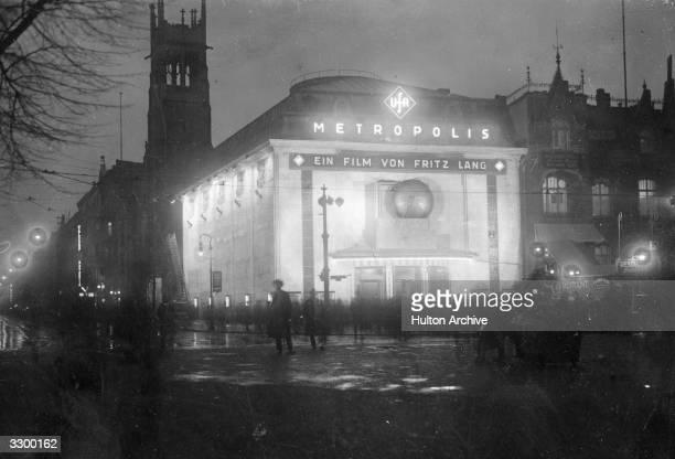 The exterior of a welllit cinema showing Fritz Lang's 'Metropolis' in Vahamorf Platz Berlin