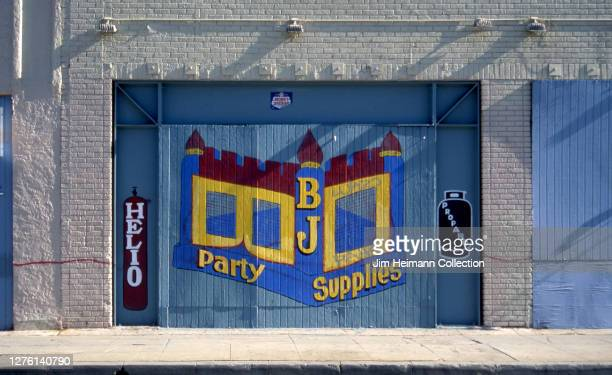 The exterior of BJ Party Supplies in Los Angeles is painted with a mural of a bounce house, 2002.