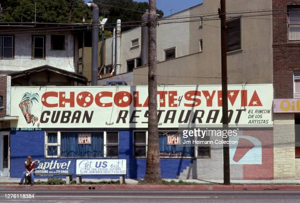 The exterior of Chocolate y Sylvia Cuban Restaurant in the Silver Lake neighborhood of Los Angeles, California has bold hand-painted letters painted...