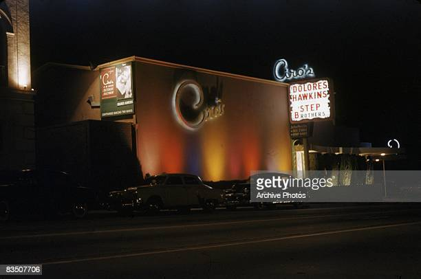 The exterior of Ciro's nightclub on the Sunset Strip at night, West Hollywood, California, circa 1955. Dolores Hawkins and the Step Brothers are...