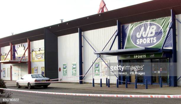 The exterior of JJB Sports in Alpine Way Beckton east London Police have announced a 36yearold sports shop manager had a gun held to his head and was...