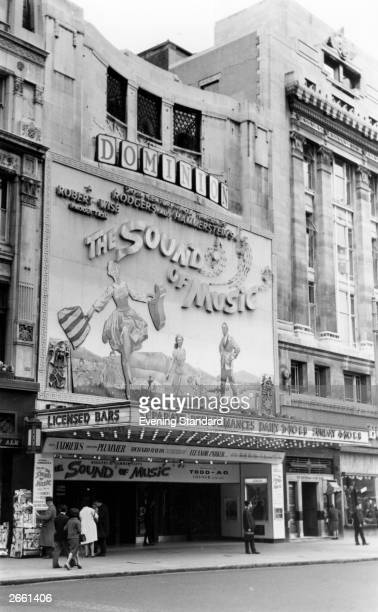 The exterior of London's Dominion Theatre, advertising the film 'The Sound of Music'.