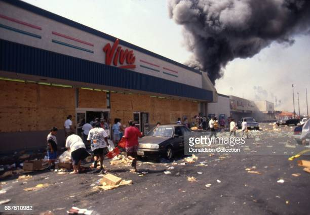The exteriror of people looting at Viva Bargain Center at 172 S Vermont Ave that erupted after the acquittal of 4 LAPD officers in the videotaped...