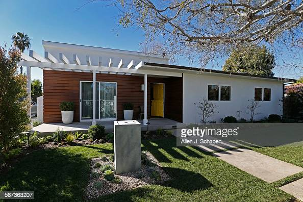 The exterior of the 1950 house offers a modern ranch update with a news photo getty images for Updating a ranch house exterior