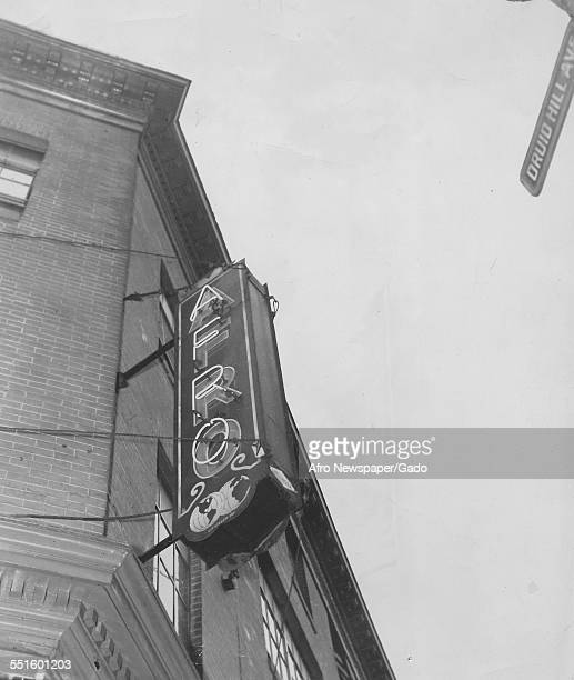 The exterior of the Afro American newspaper offices and a sign viewed from below Baltimore Maryland 1948