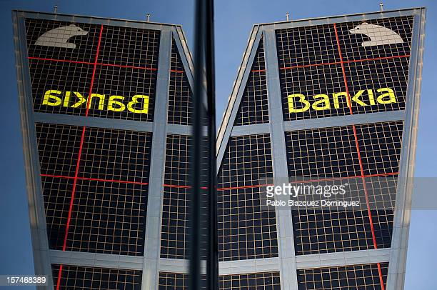 The exterior of the Bankia building at Plaza de Castilla is reflected in a window on December 3 2012 in Madrid Spain Spain has formally requested 395...