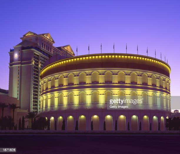 The exterior of The Colosseum at Caesars Palace where singer Celine Dion's concert A New Day will be held is seen at night in Las Vegas Nevada...
