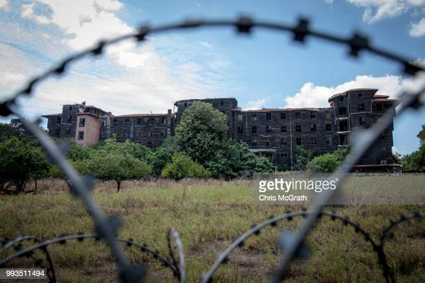 The exterior of the dilapidated Prinkipo Greek Orthodox Orphanage is seen through barbed wire fencing on July 7 2018 in Buyukada Turkey The historic...
