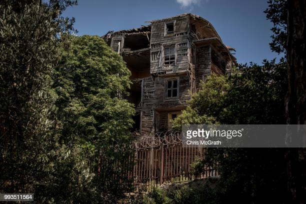 The exterior of the dilapidated Prinkipo Greek Orthodox Orphanage is seen on July 7 2018 in Buyukada Turkey The historic 20000squaremeter wooden...