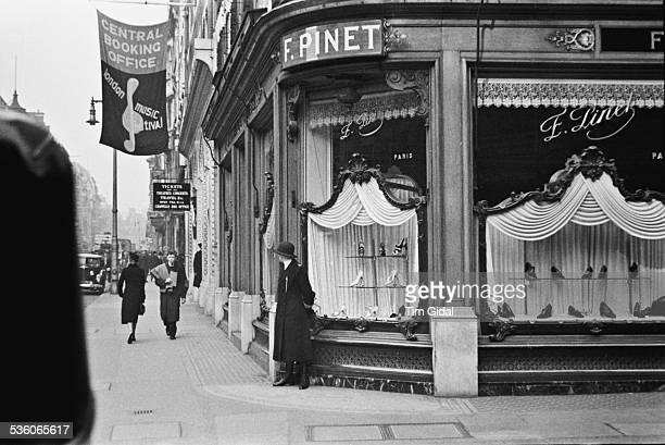 The exterior of the F Pinet shoe shop on Bond Street London May 1939 Original publication Picture Post 67 Bond Street pub 20th May 1939