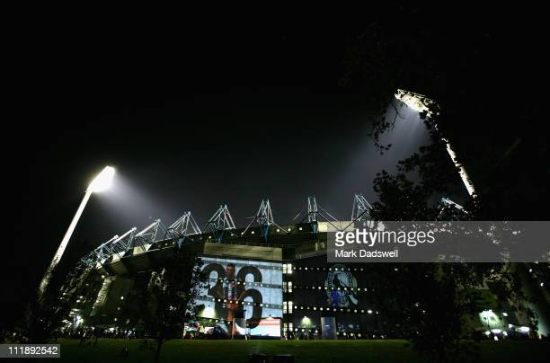 The exterior of the MCG is illuminated with Collingwood players photos and logos during the round three AFL match between the Collingwood Magpies and...