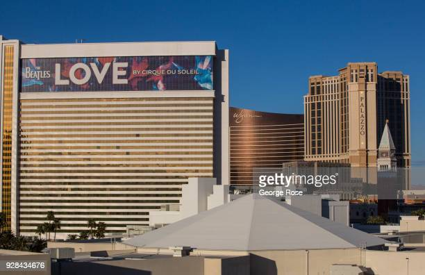 """The exterior of The Mirage Hotel & Casino, featuring a billboard of The Beatles Cirque du Soleil """"Love"""" show, is viewed on March 2, 2018 in Las..."""