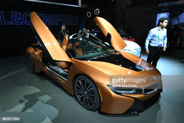 The exterior of the new updated BMW I8 sports car on display at the 2017 LA Auto Show in Los Angeles California on November 29 2017 / AFP PHOTO /...