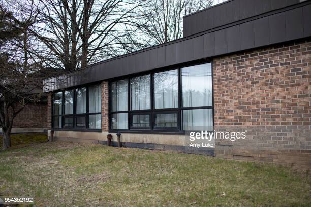 The exterior of the NXIVM Executive Success Programs office at 455 New Karner Road on April 26 2018 in Albany New York Keith Raniere founder of NXIVM...
