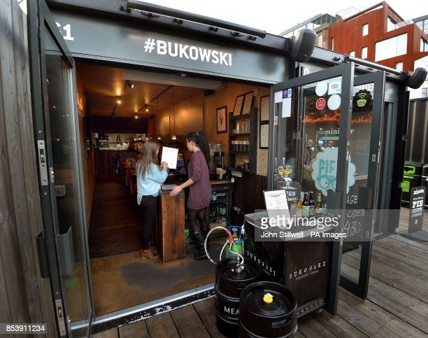 The exterior of the popular Bukowski Burger bar in Boxpark Shoreditch east London which serves a Fat Gringo burger the beef patty is cooked in a...