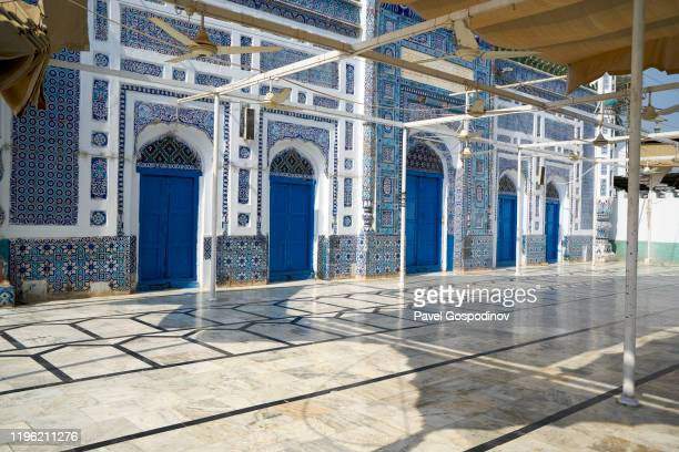 the exterior of the shrine of the sufi saint and poet shah abdul lateef bhitai in the town of bhit, pakistan - shrine stock pictures, royalty-free photos & images