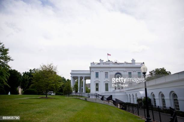 The exterior of the White House is seen before US Vice President Mike Pence speaks during an Infrastructure Summit Working Luncheon June 8 2017 in...