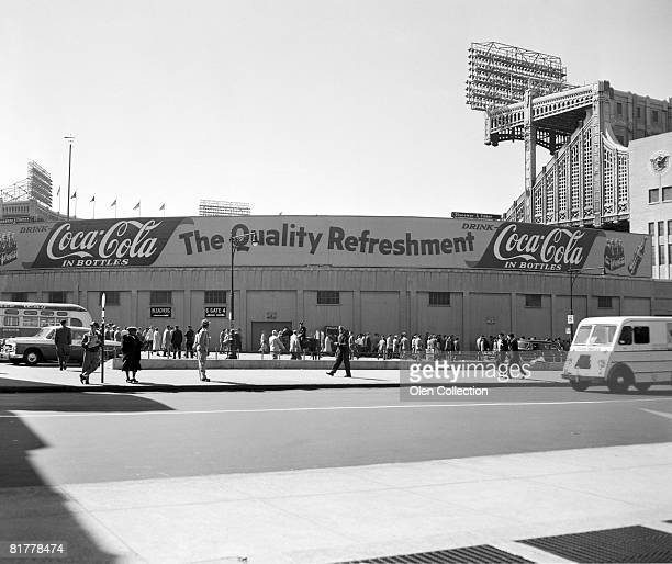 The exterior of Yankee Stadium shows the new advertisement for Coca Cola spanning the area behind the bleachers and above the exits to the street and...