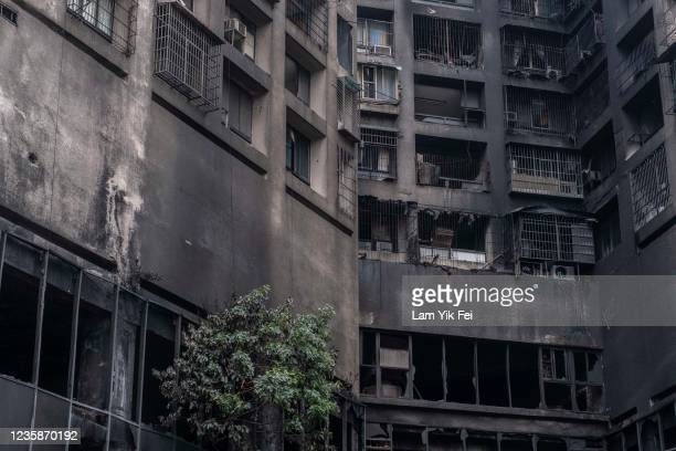 The exterior walls of a residential building stands charred in the wake of a fire on October 14, 2021 in Kaohsiung, Taiwan. Additional deaths are...