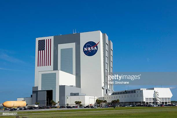 The external tank for Space Shuttle Atlantis mission STS129 is transported into the Vehicle Assembly Building at the Kennedy Space Center August 4 in...