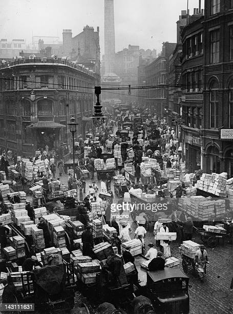 The extra busy scene at the Billingsgate Fish Market in London showing carts and lorries loaded with fish in readiness for delivery to shopkeepers...