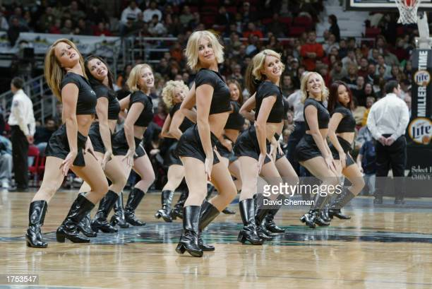 The Extreme Team entertains the audience during the NBA game between the Los Angeles Clippers and the Minnesota Timberwolves at Target Center on...